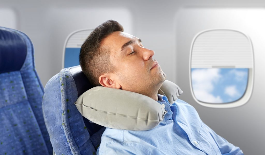 What's the best way to sleep on a plane?
